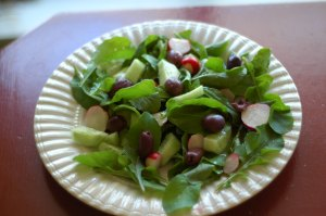 Cucumbers, Olives, Radish, Arugula and Feta Salad --photo by Anna Migeon