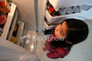 Stock girl looking in fridge